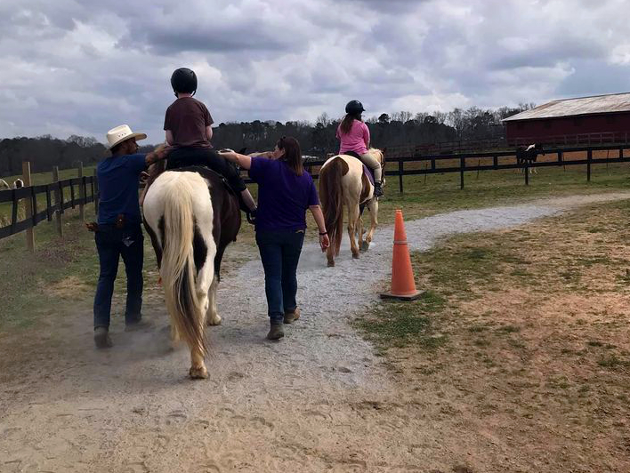 Junior Girl Scouts visit Bearfoot Ranch and Volunteer